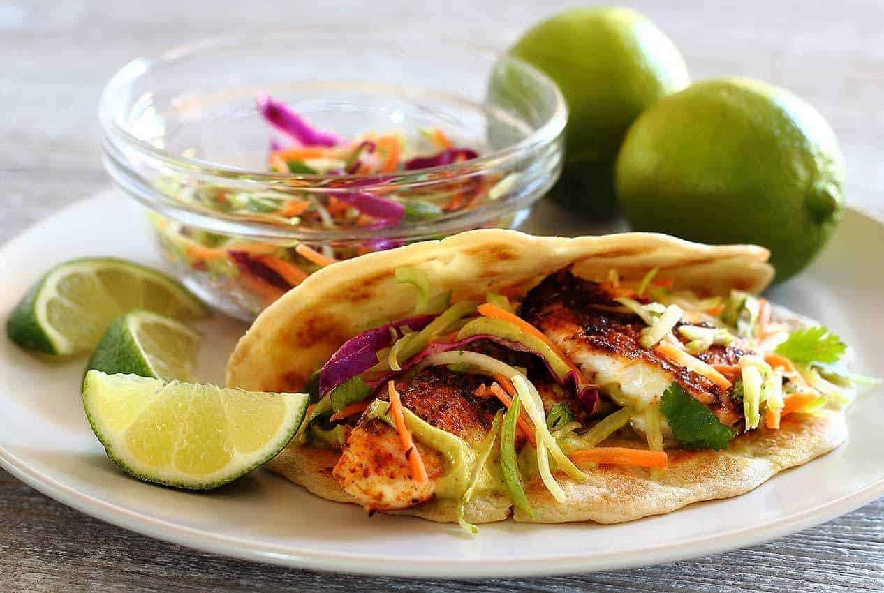 Paleo Spicy Tilapia Baja Taco with Lime Slaw and Avocado Cilantro Sauce